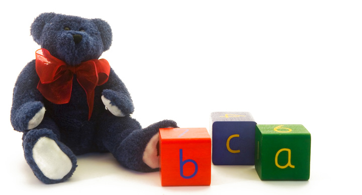 Teddy bear with alphabet blocks